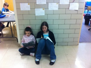 Miss Lee and Kira take time out to read!